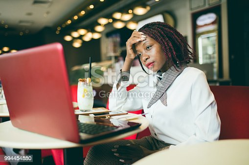 istock Tired Woman During After Hours In Cafe 994454880