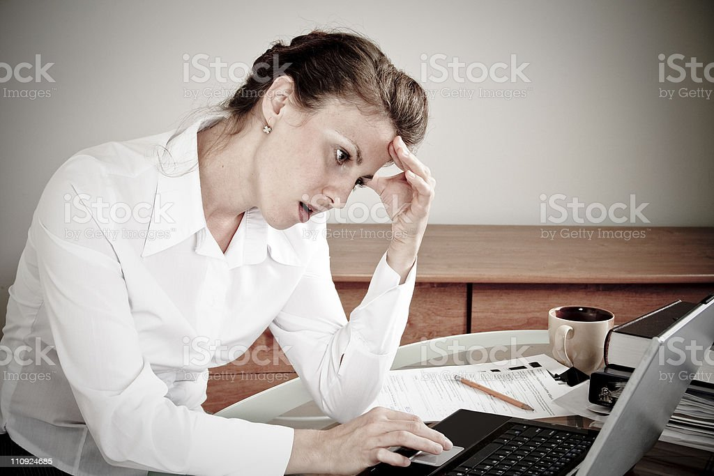 Tired woman in office royalty-free stock photo