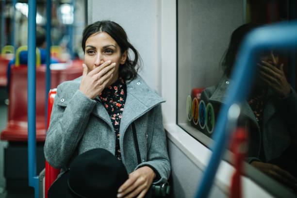 trött kvinna i kollektivtrafiken - winter austria train bildbanksfoton och bilder
