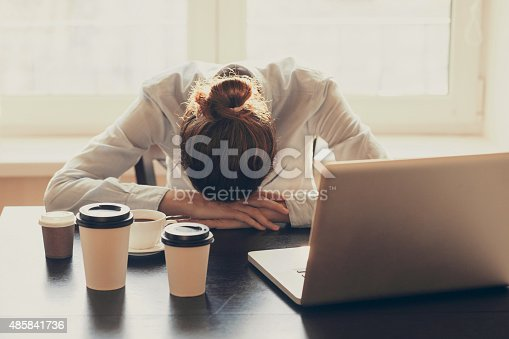 istock Tired woman in the office 485841736