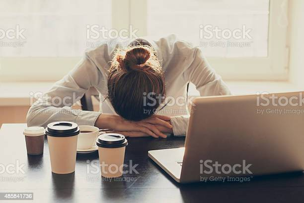 Tired Woman In The Office Stock Photo - Download Image Now