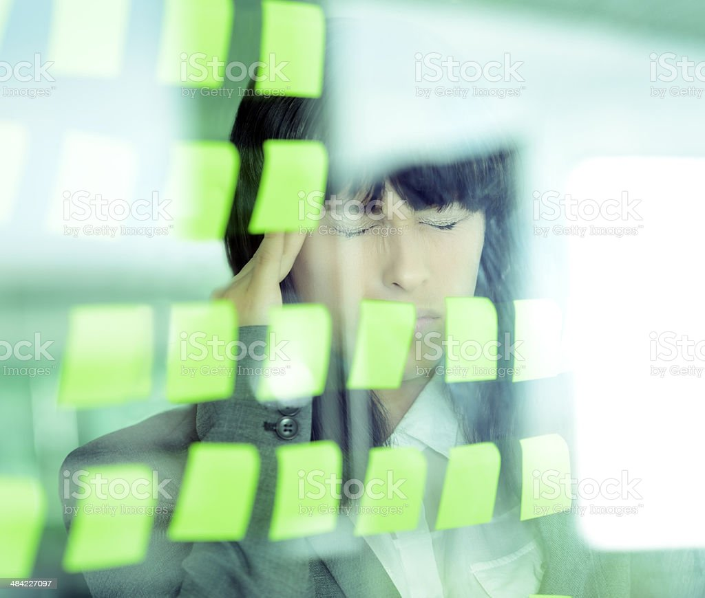 tired woman near post its royalty-free stock photo