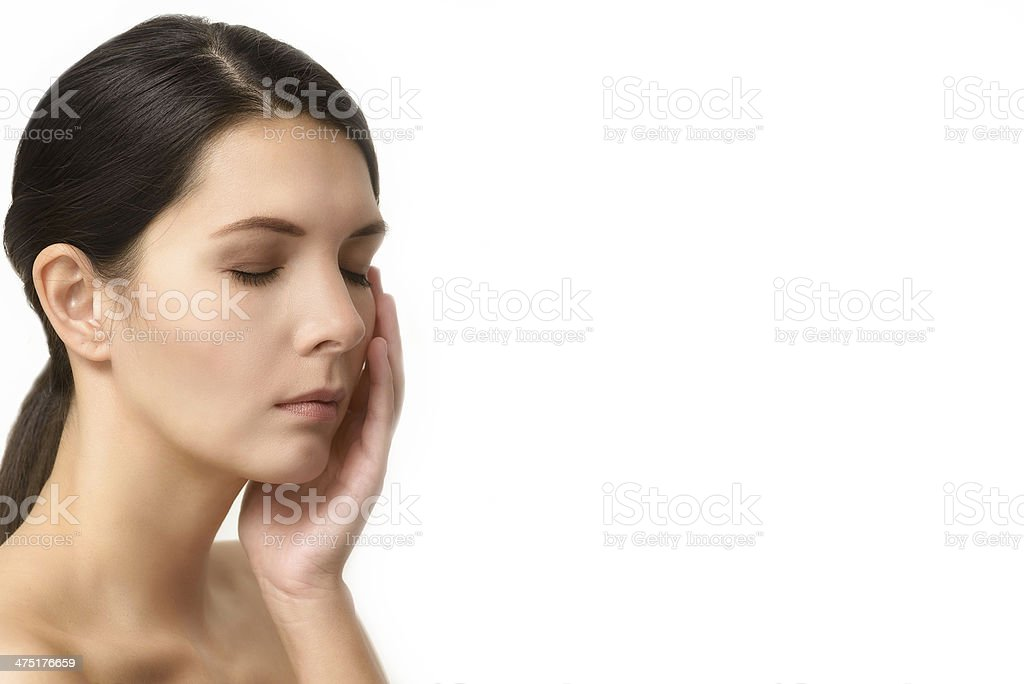 Tired woman relaxing with closed eyes royalty-free stock photo