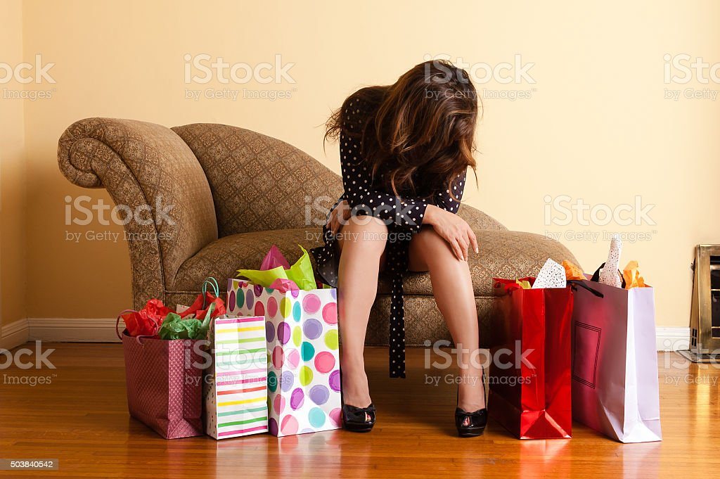 Tired woman resting after a shopping spree royalty-free stock photo