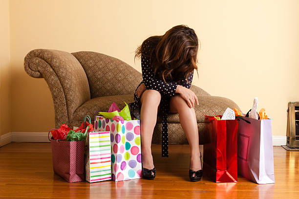 Tired woman resting after a shopping spree stock photo
