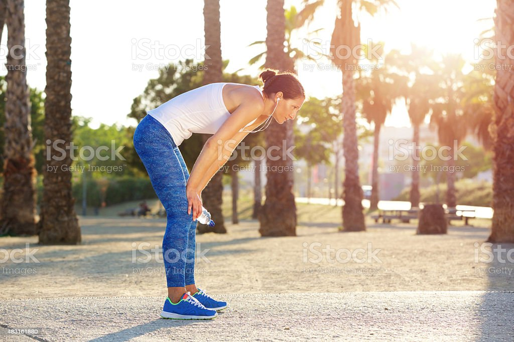 Tired woman resting after workout exercise stock photo