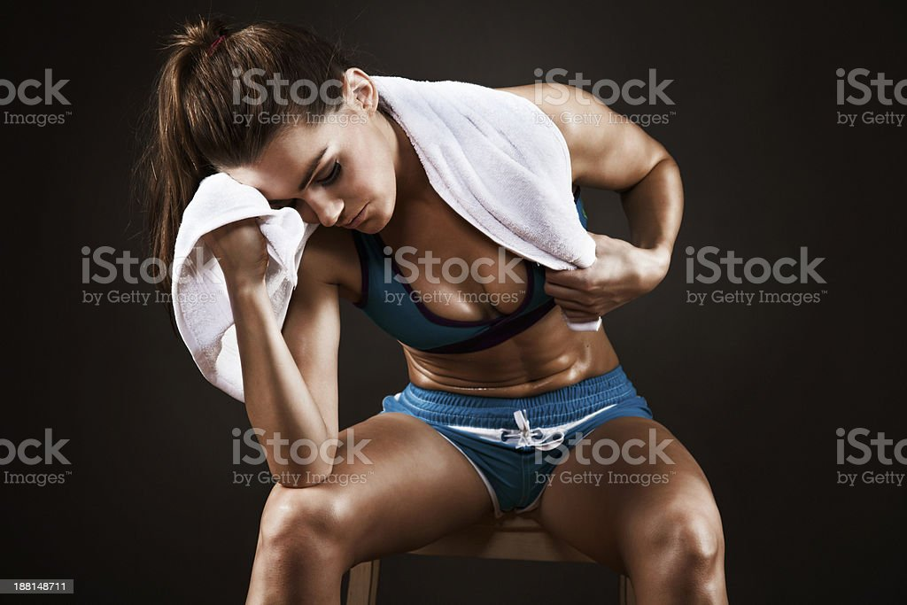 Tired woman resting after workout royalty-free stock photo