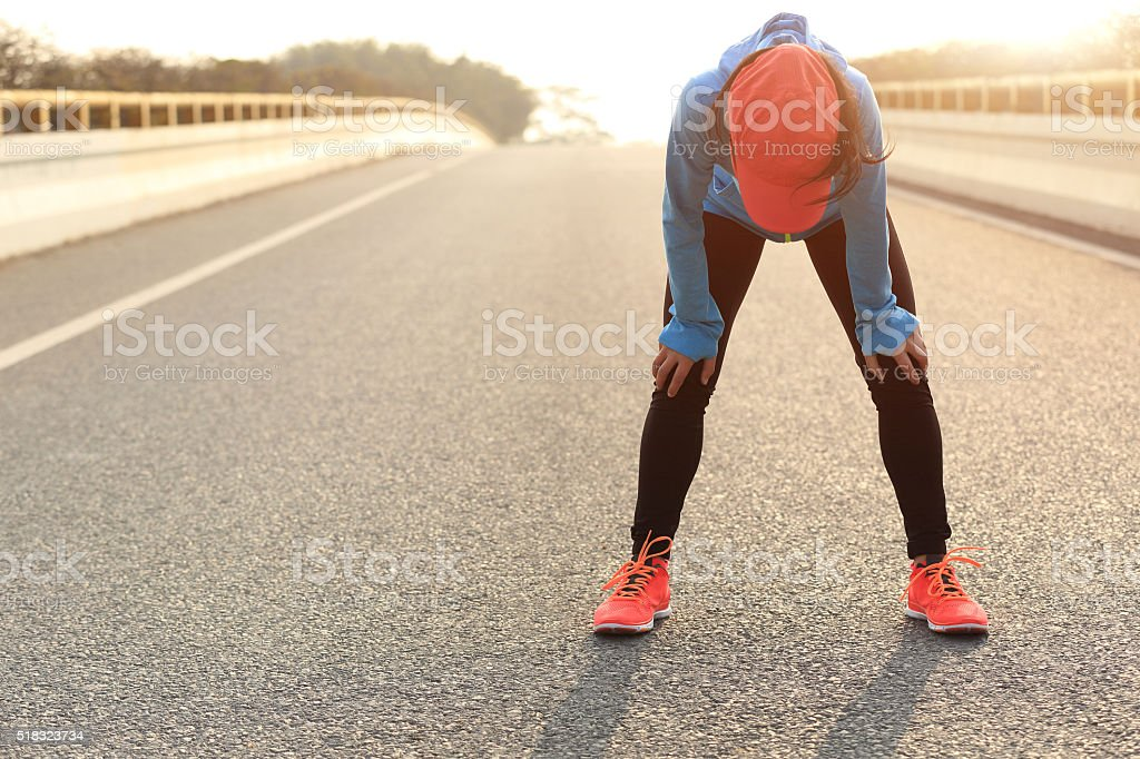 tired woman runner taking a rest after running hard royalty-free stock photo
