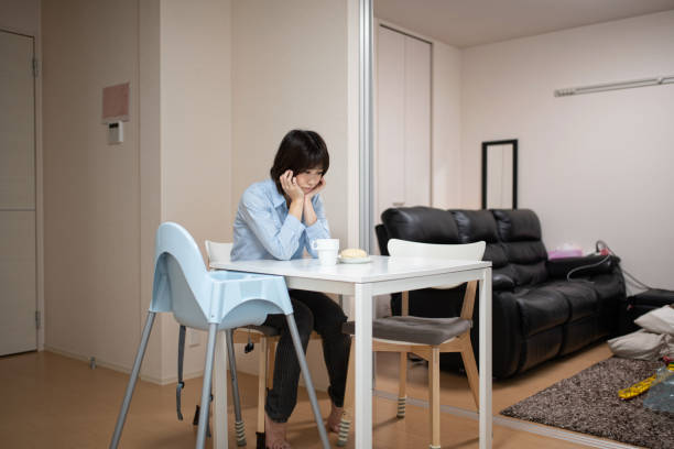 tired woman sitting on chair - stay at home parent stock pictures, royalty-free photos & images