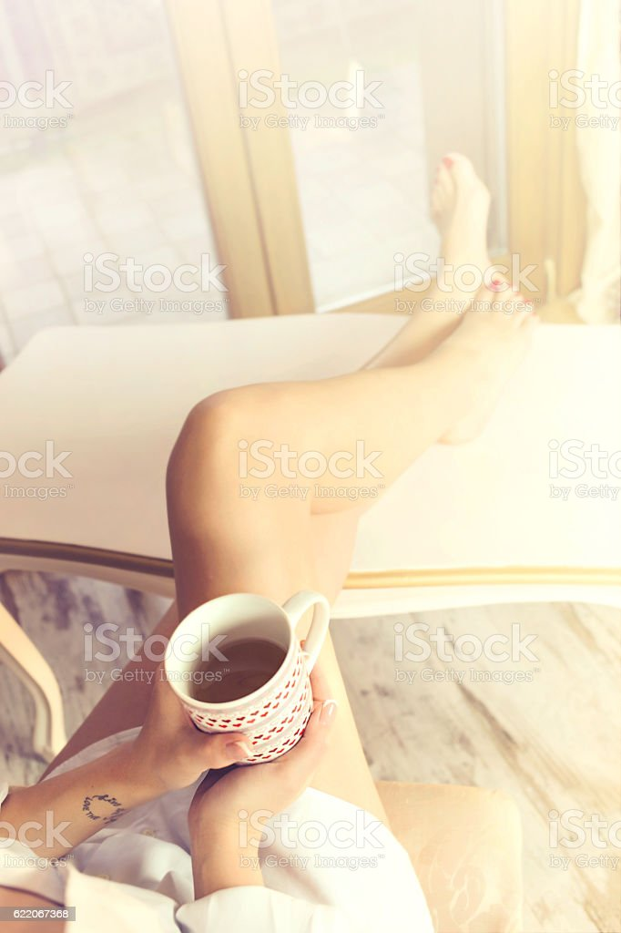 tired woman takes a break in her home, tea time stock photo
