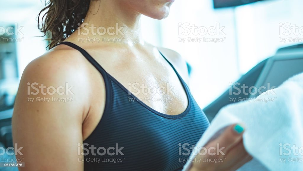 Tired woman wiping face after work out royalty-free stock photo