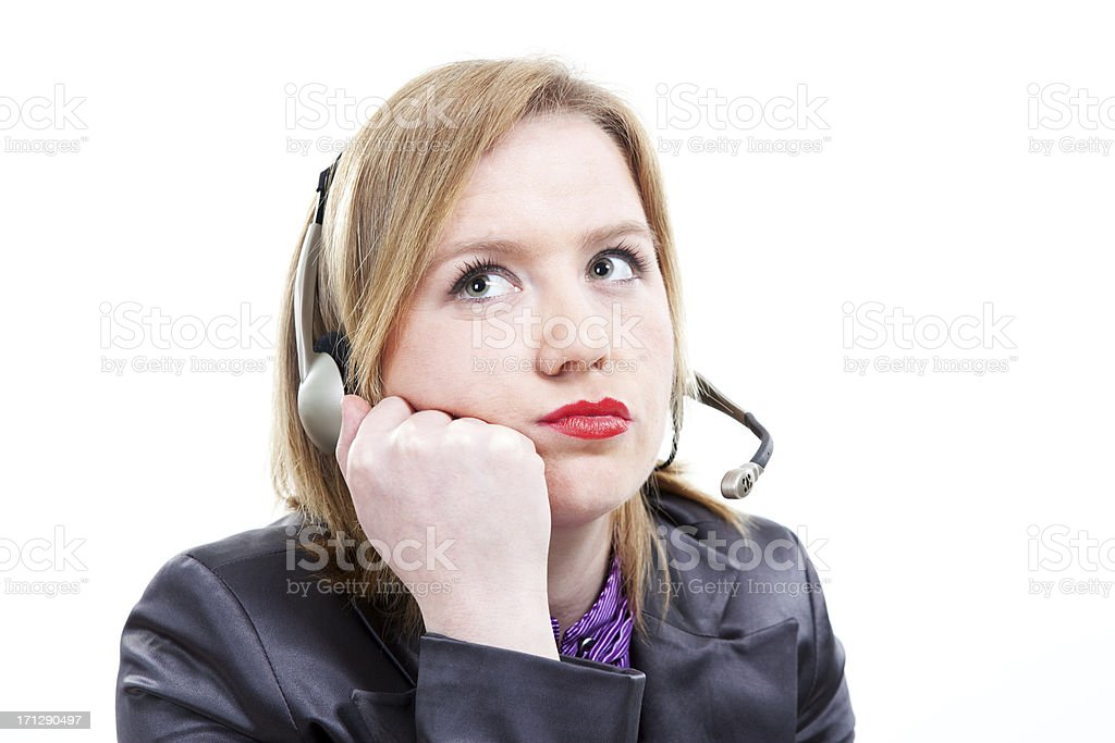 Tired Woman with telephone headset stock photo