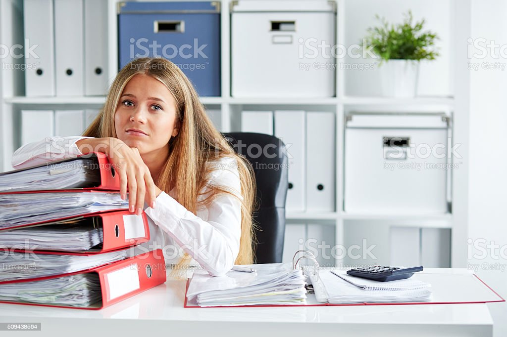 Tired young business woman stock photo