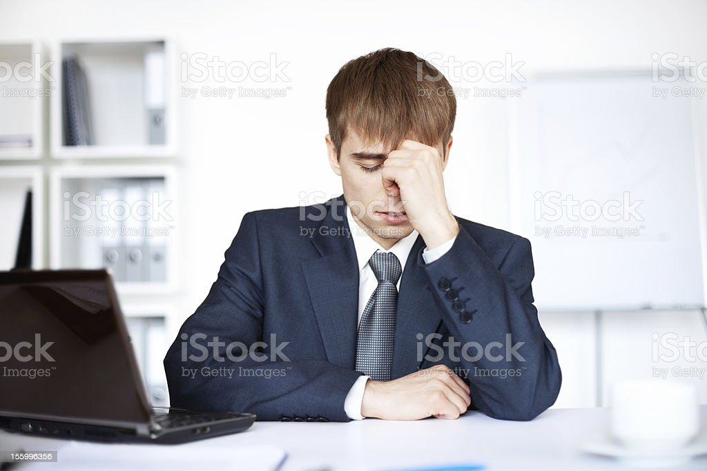 Tired young businessman with problems and stress royalty-free stock photo