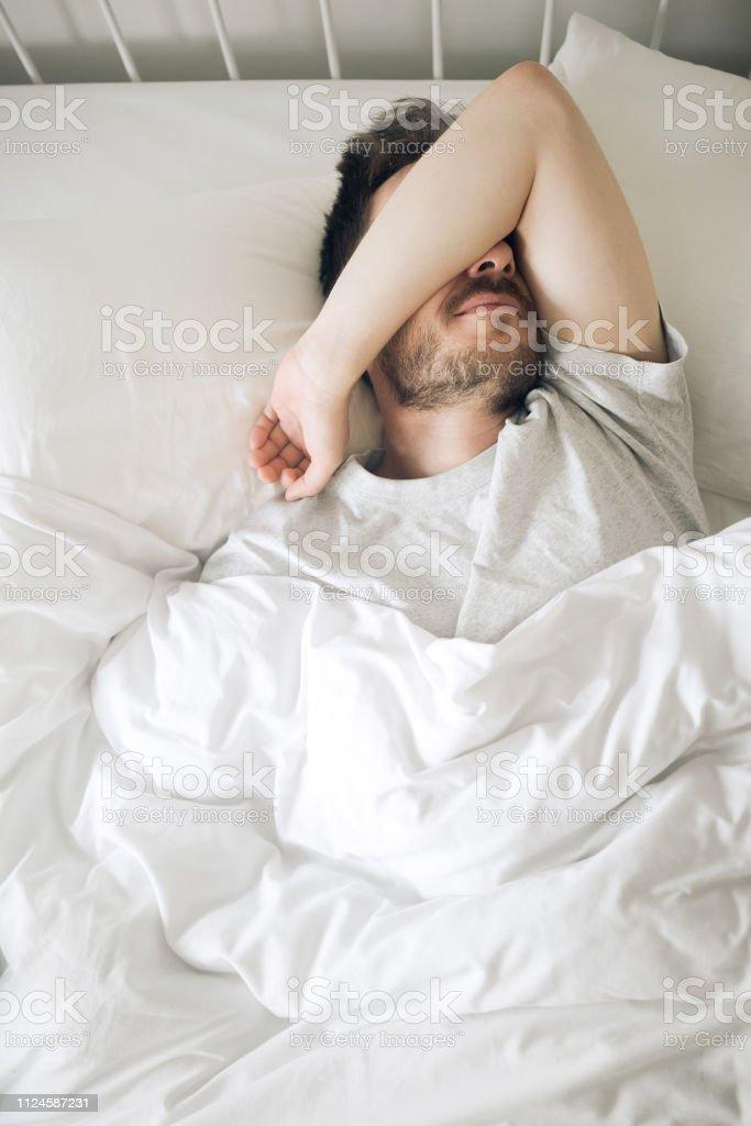 Lifestyle portrait of sleeping man