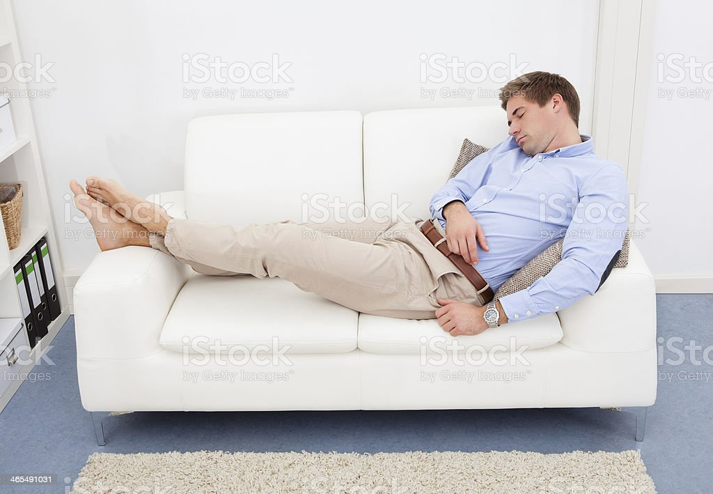 Tired Young Man On Couch royalty-free stock photo