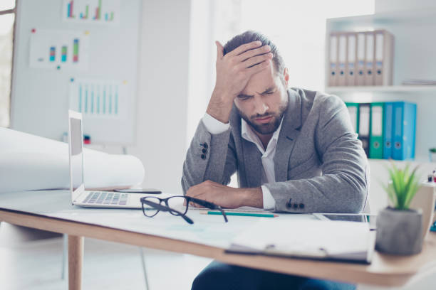 Tired young overworked businessman touch the head and feel strong pain Tired young overworked businessman touch the head and feel strong pain aftereffect stock pictures, royalty-free photos & images