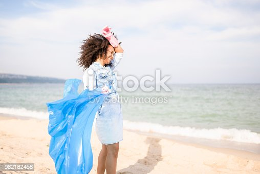 962184460 istock photo Tired young woman during local clean up at the beach 962182458