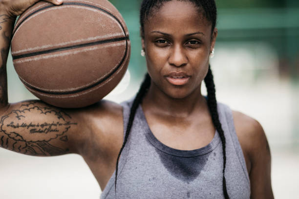 Tired young woman holding  the ball - foto stock