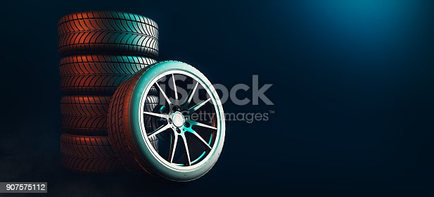 istock Tires 5 lines on a black background. 907575112