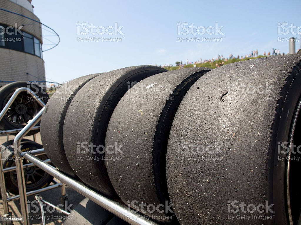 Tires are stalled behind the pitlane during a race stock photo