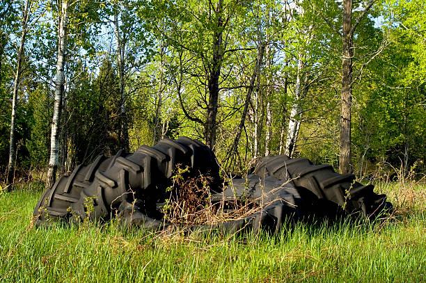 Tires dump site in nature stock photo
