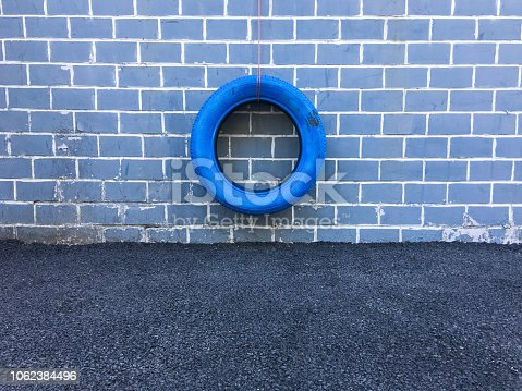 Tires that hang from the street walls