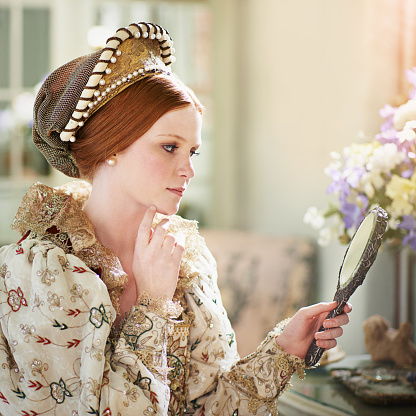 Shot of an elegant noble woman admiring herself in a mirror in her palace roomhttp://195.154.178.81/DATA/i_collage/pi/shoots/784228.jpg