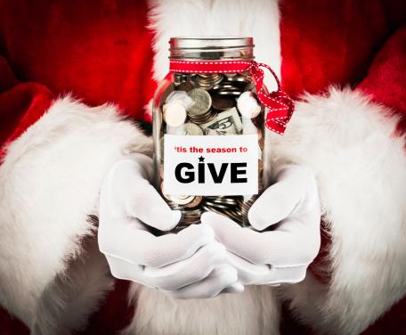 Santa with donation jar.