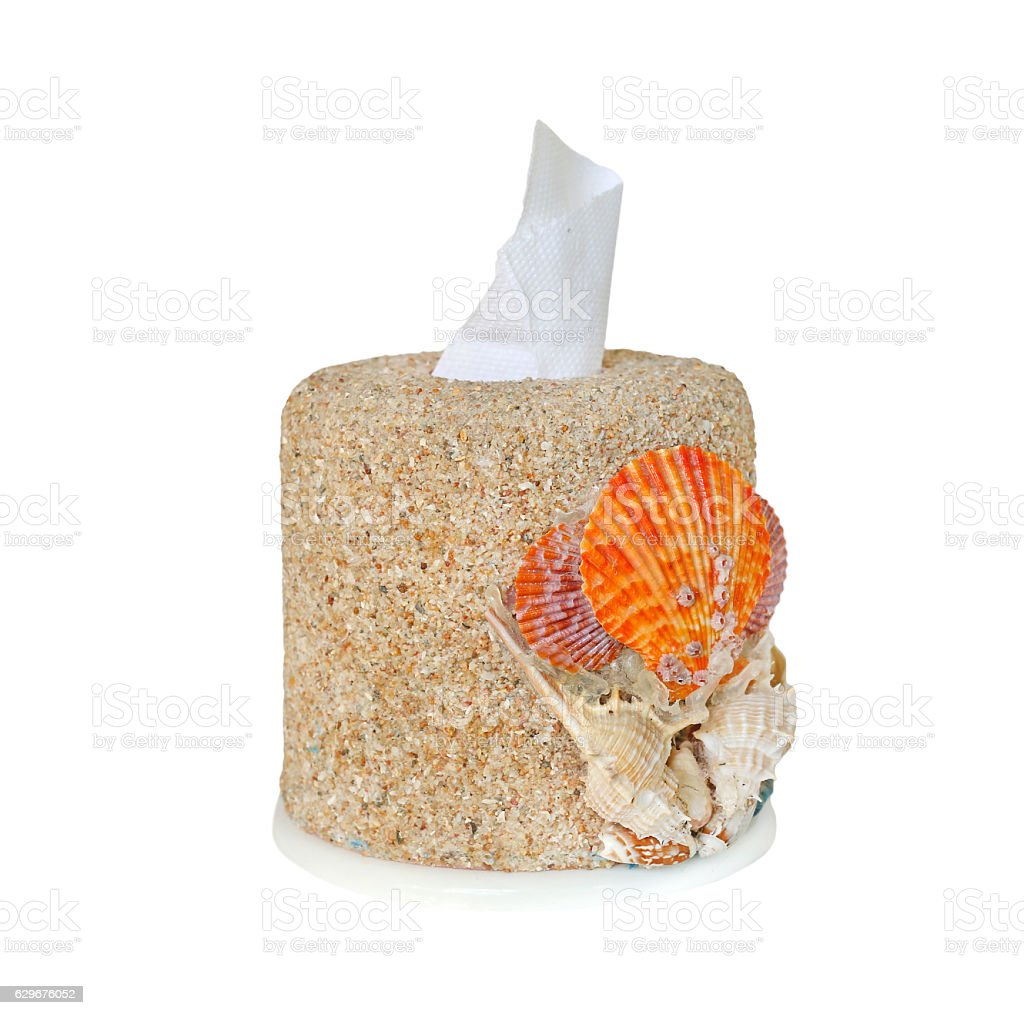 Tissue box decorate with shell and sand stock photo