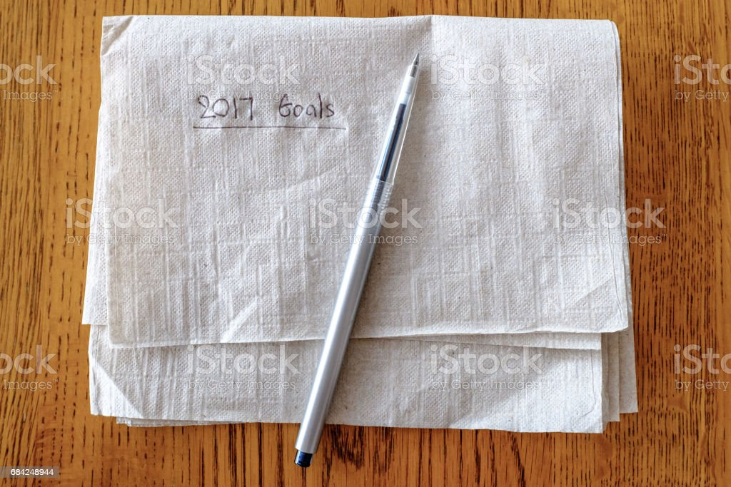 Tissue paper and pen on wooden table with inspirational words royalty-free stock photo