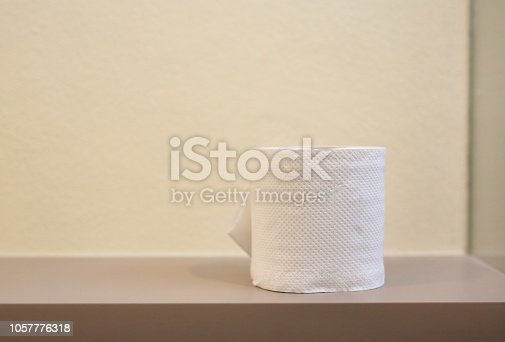 istock Tissue paper in toilet room. 1057776318