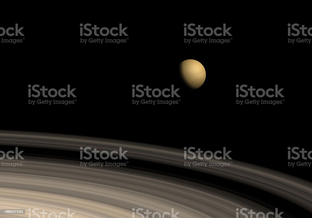 Titan and Saturn's rings stock photo