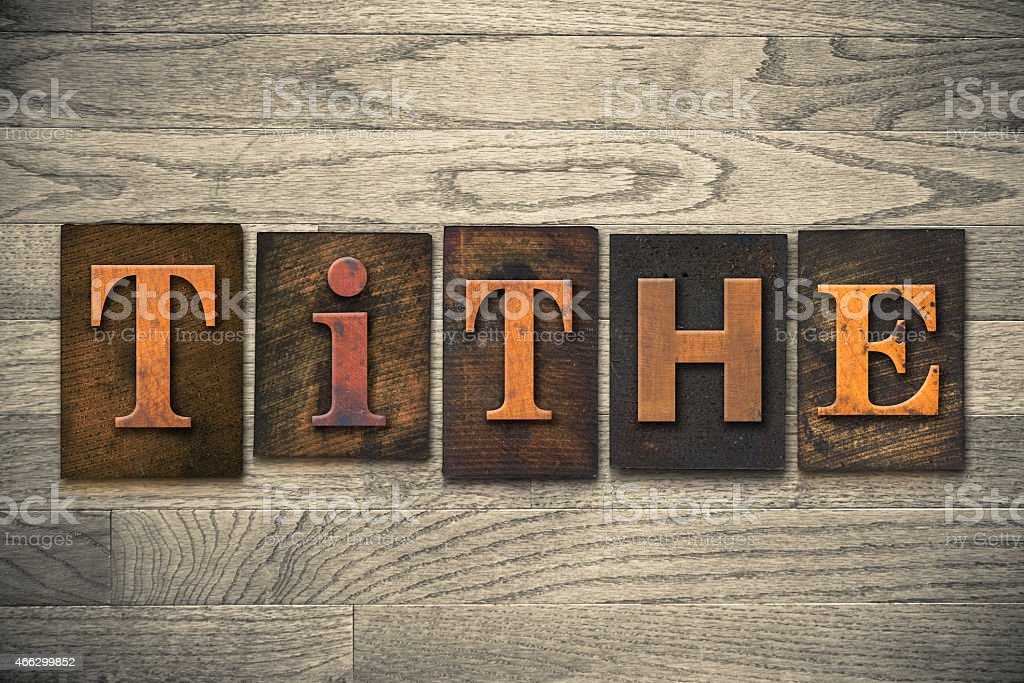 Tithe Concept Wooden Letterpress Type stock photo