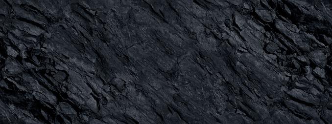 Stone grunge banner. Dark gray rock backdrop.