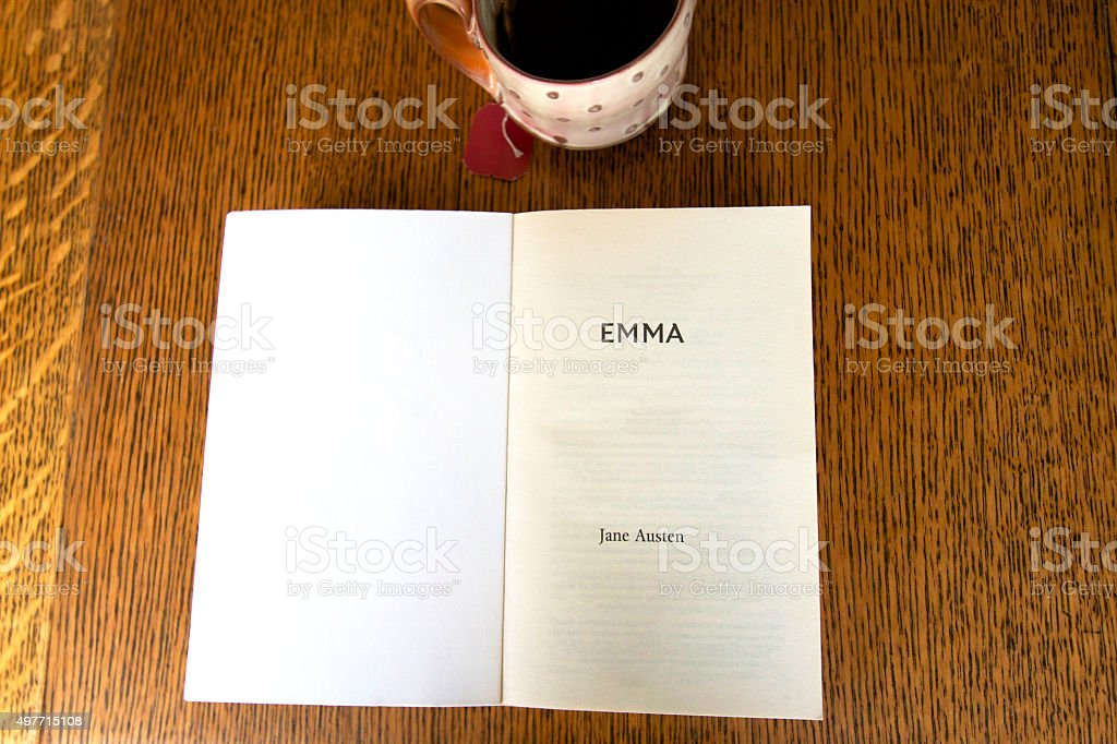 Title Page: 'Emma, Jane Austen', Cup of Tea, Wood Background stock photo