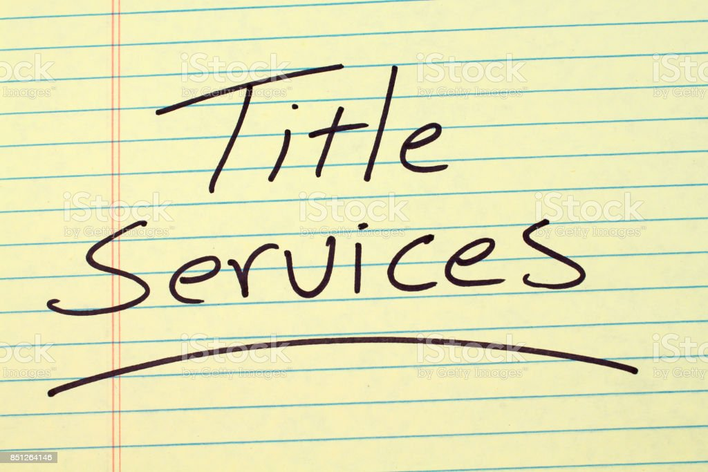 Title Services On A Yellow Legal Pad stock photo