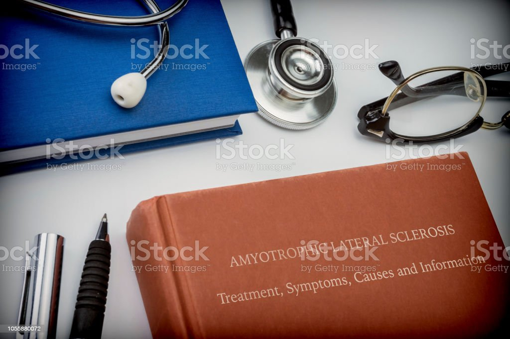 Titled book Amyotrophic Lateral Sclerosis along with medical equipment, conceptual image stock photo