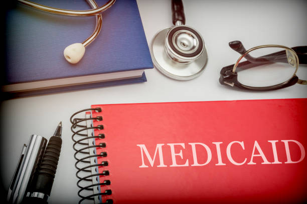 titled red book medicaid along with medical equipment, conceptual image - политика и правительство стоковые фото и изображения