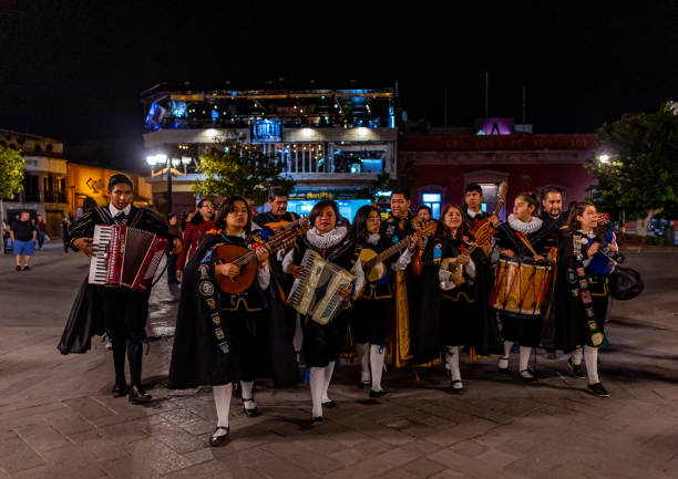 Tlaquepaque San Luis Potosi, San Luis Posoti, Mexico - November 22, 2019: Young men and women wearing traditional clothing playing music at the Plaza del Carmen san luis potosi stock pictures, royalty-free photos & images