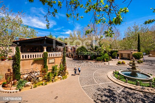 Sedona, Arizona USA - May 2, 2017: The Tlaquepaque Arts and Crafts Village, with vintage adobe style architecture, is a popular tourist destination filled with retail shops and restaurants.
