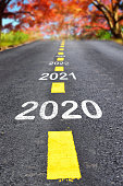 istock 2020 to 2023 on asphalt road surface with autumn season background 1192118115