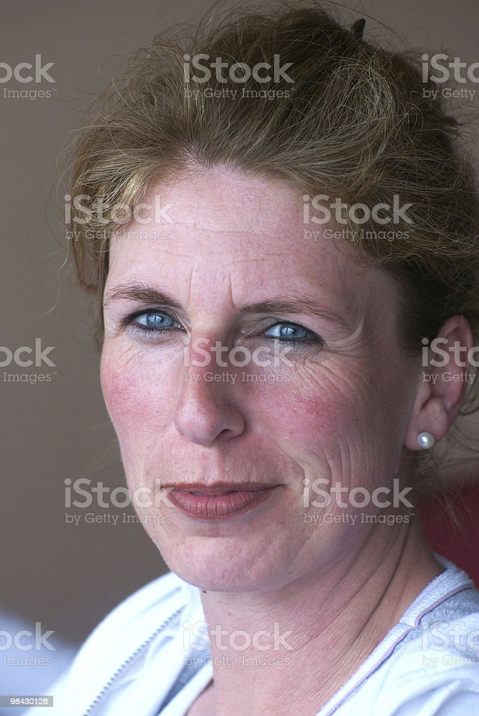 30 to 40 year-old woman with blue eyes, smiling royalty-free stock photo