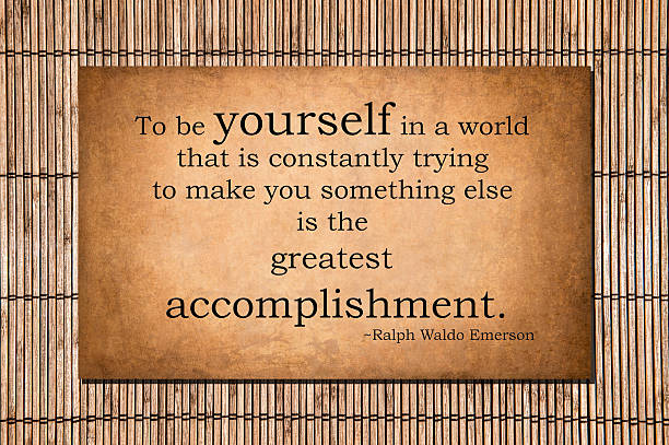 To be yourself - Ralph Waldo Emerson quote stock photo
