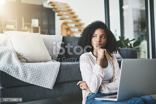 Shot of an attractive young woman relaxing at home