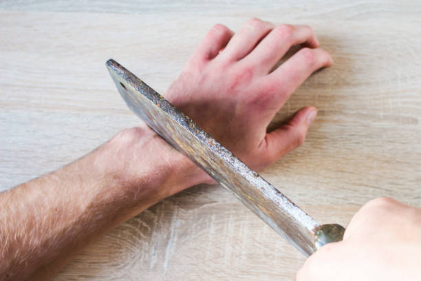 to cut off a hand with an ax stock photo