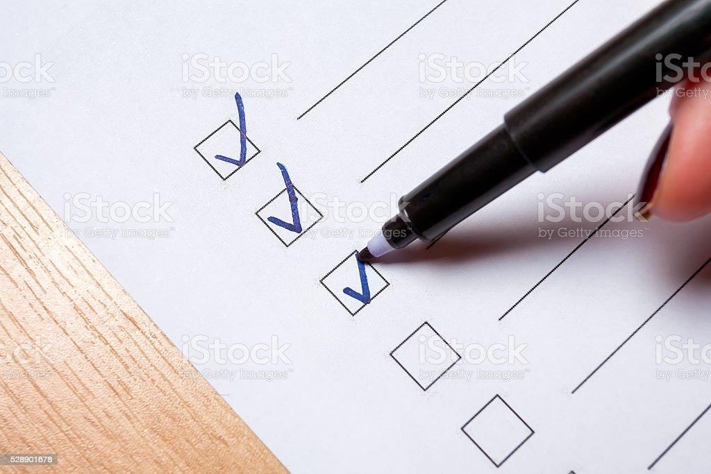 To do checklist on a light floor. stock photo