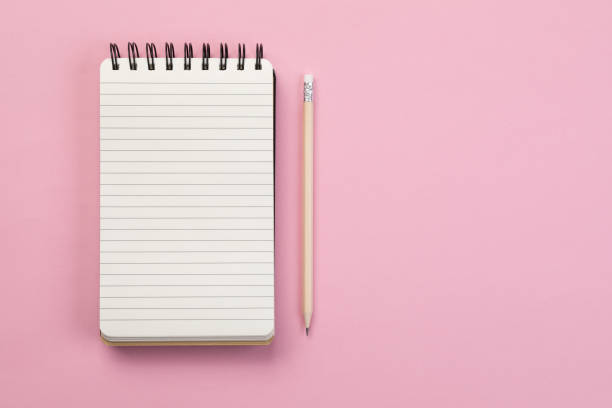 To do list - Concept Spiral notebook and pencil on pink background note pad stock pictures, royalty-free photos & images
