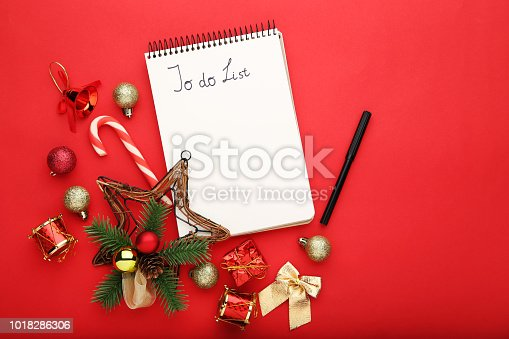 to do list in notepad with christmas decorations on red background stock photo more pictures of ball istock