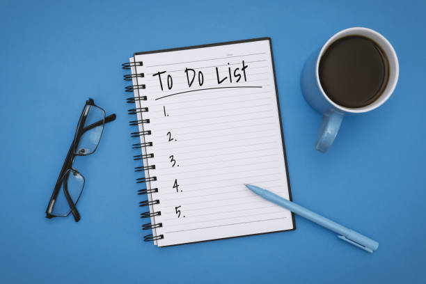 to do list on notebook over pastel blue background - to do list foto e immagini stock